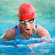 Athletic swimmer in action in a swimming pool — Stock Photo #9501240