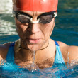 Athletic swimmer in action in a swimming pool — Stock Photo #9501241