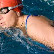 Athletic swimmer in action in a swimming pool — Stock Photo #9501243