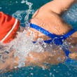 Athletic swimmer in action in a swimming pool — Stock Photo #9501244