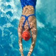 Athletic swimmer in action in a swimming pool — Stock Photo #9501245