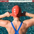 Athletic swimmer is diving in a swimming pool  — Stock Photo