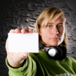 Portrait from a disc jockey with blank business card — Stock Photo #9501271