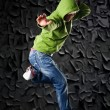 Hip Hop dancer on a street in the night - Stock Photo