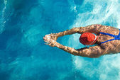 Athletic swimmer in action in a swimming pool — Stock Photo