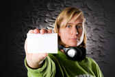 Portrait from a disc jockey with blank business card — Stock Photo