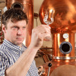 Man in front of distillery - copper — Stock Photo #9513335