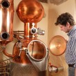 Man in front of distillery - copper — Stock Photo #9513340
