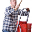 Craftsman on a ladder with a brush - Stock Photo