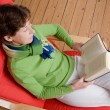 Reading a book — Stock Photo #9516167