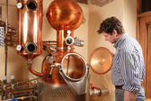 Man in front of distillery - copper — Stock Photo