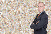 Businessman with euro bills — Stock Photo