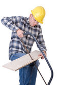 Craftsman with saw — Stock Photo
