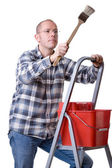 Craftsman on a ladder with a brush — Stock Photo