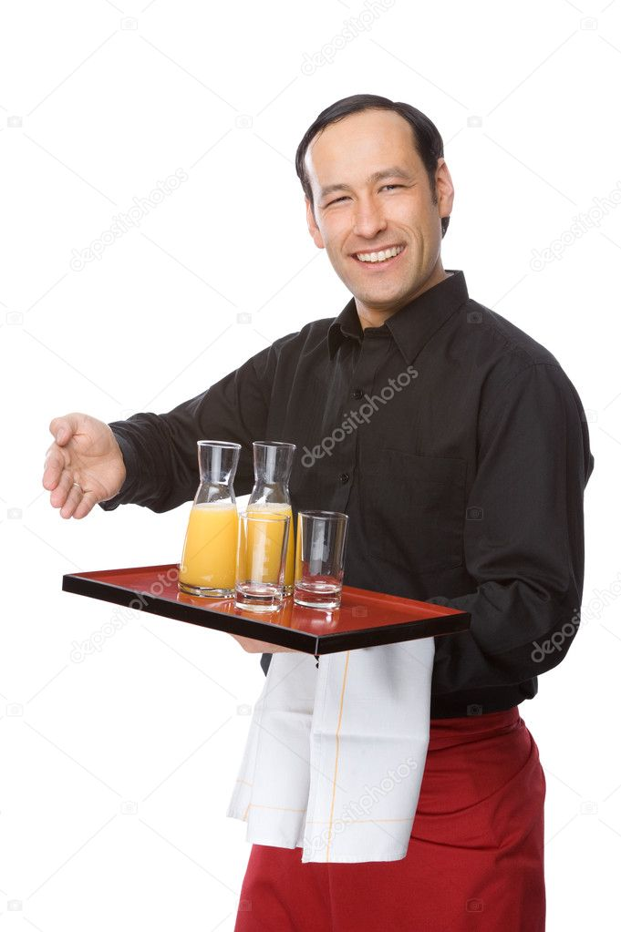 Male waiter smiling and pouring orange juice — Stock Photo #9517157