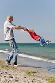 At the beach — Stock Photo