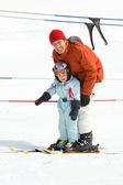 Family skiing — Stock Photo