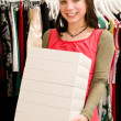 Customer in clothing shop — Stock Photo