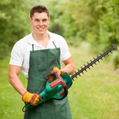 Gardener with hedge trimmer — Stock Photo