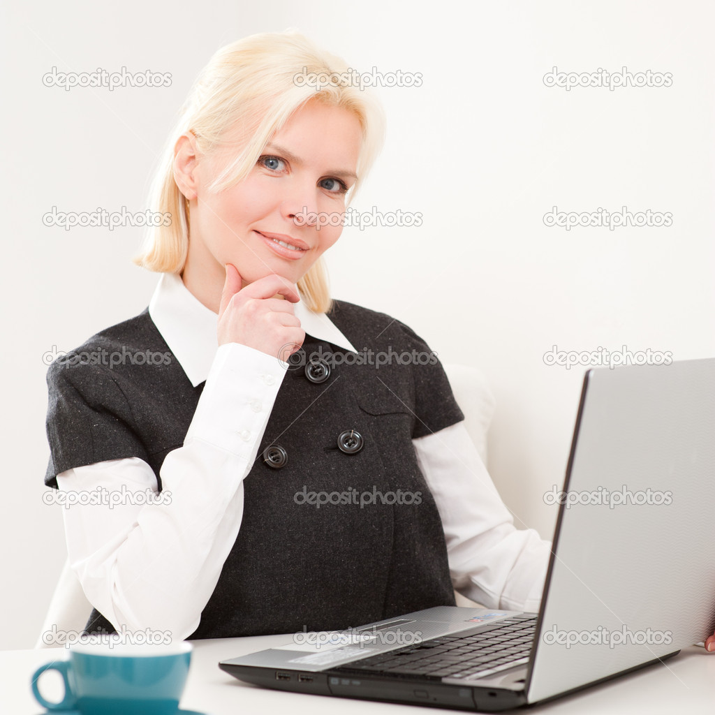 Young and beautiful business woman at work  Stock Photo #9831889