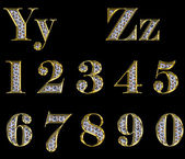 Golden alphabet with diamonds — Stock Photo