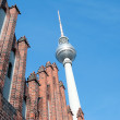 Berlin Alexanderplatz - TV tower and Marienkirche - Stock Photo