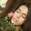 Young woman with flowers - Photo