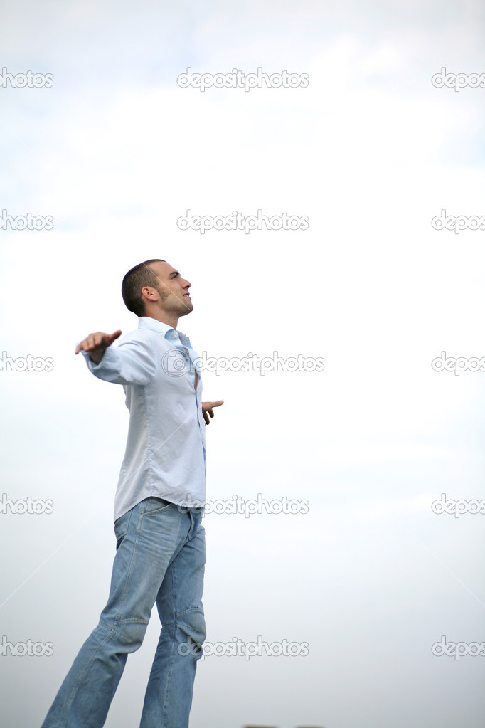 Young man outdoors enjoys the moment — Stock Photo #10336720