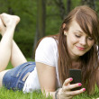 Happy young woman with phone - Stock Photo