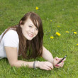 Royalty-Free Stock Photo: Happy girl in the park with phone