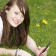 Happy girl with phone - Foto Stock