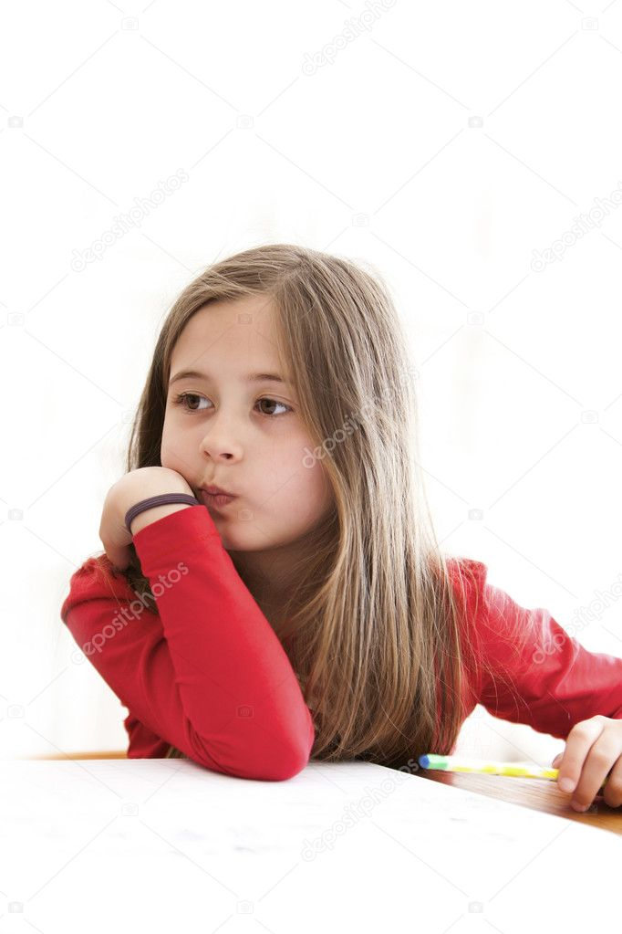 Little school girl looks distracted from her homework — Stock Photo #10468083