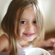 Cute girl having breakfast - Stok fotoğraf