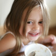 Young girl with breakfast. - Foto de Stock