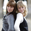 Outdoor portrait of two young women - Foto de Stock