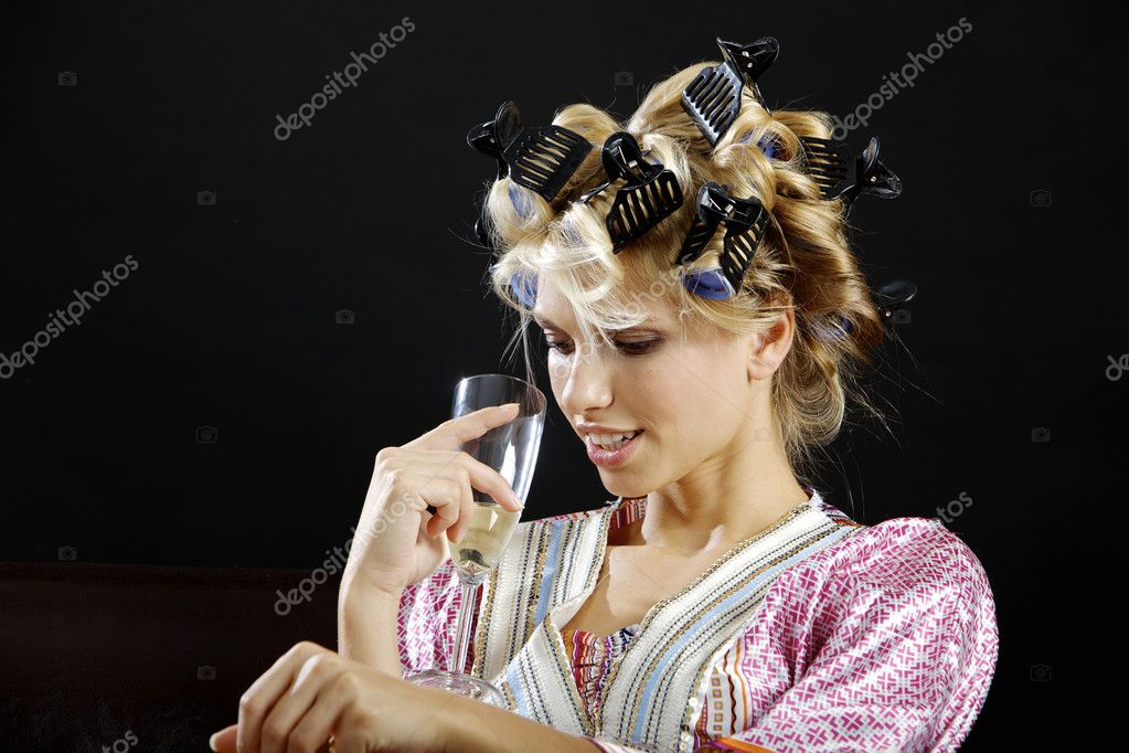 Young housewife looking at her white wine glass and smiling — Stock Photo #9223158