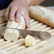 Slicing bread - Stock Photo