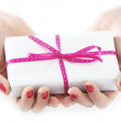 Hands holding beautiful gift - Stock Photo