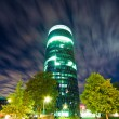 Office skyscraper at night — Stock Photo