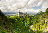 Castle Neuschwanstein in the mountains — Stock Photo