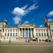 Reichstag in Berlin on sunny day - Stock Photo