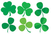 Set of six stylized clovers — Vector de stock