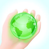 Human hand holding a green globe — Stock Vector