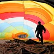 Man inside a colorful hot air balloon inflating — Stock Photo