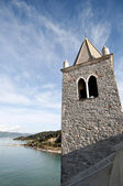 A bell tower, the sea and the sky — Stock Photo