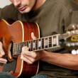 Playing 12 string acoustic guitar — Stock Photo #9814836