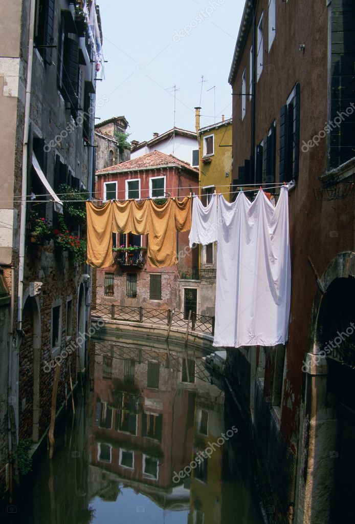 Italy, Venice, laundry strung across canal  Stock Photo #9219083