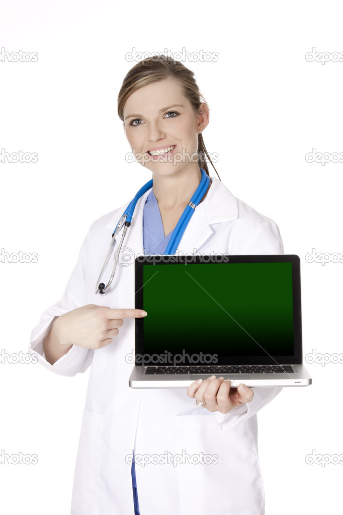 Beautiful Caucasian doctor holding a laptop computer and pointing at the screen.  There is clipping path around the computer screen — Stock Photo #9142723