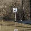 Road leading into flood waters — Stock Photo