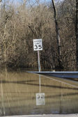 Road leading into flood waters — Stockfoto